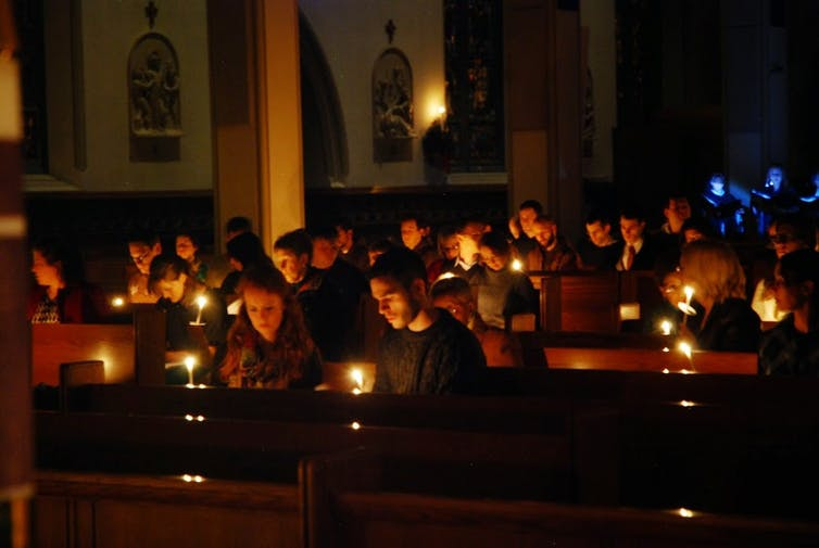 Religious people With Candles In Church
