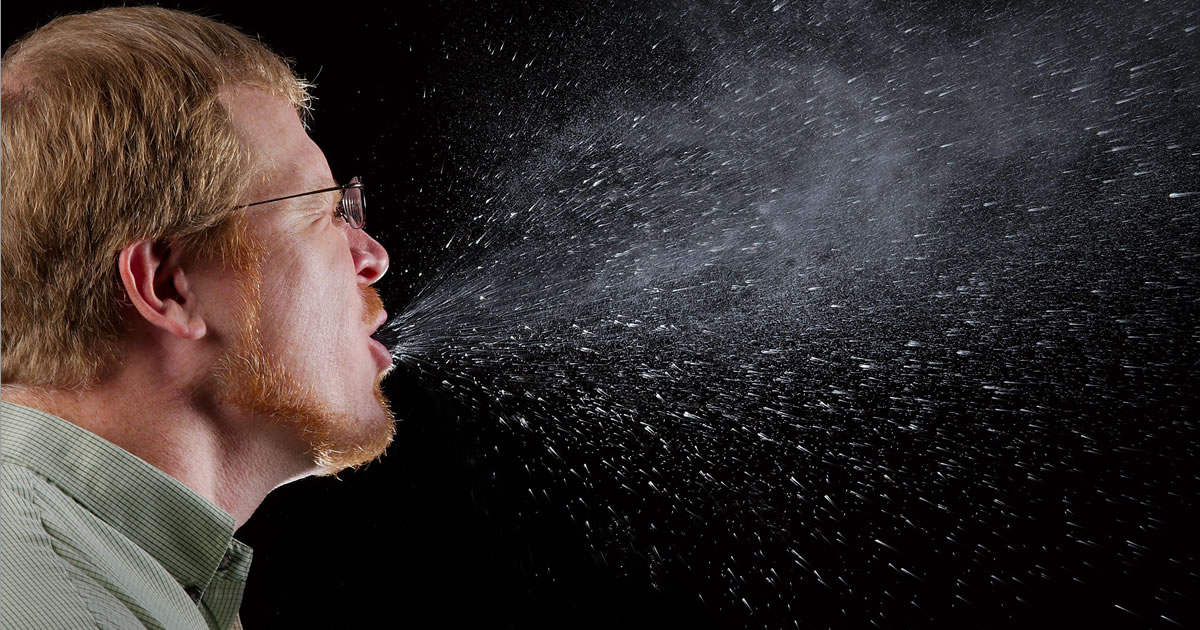 Man Coughing Visible Particles in to the Air Featured