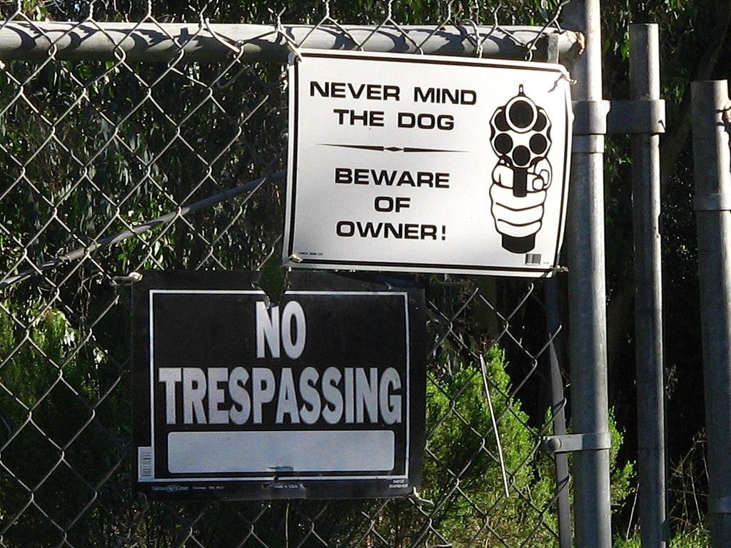 Never Mind the Dog, Beware Of Owner Sign. Vigilantism.