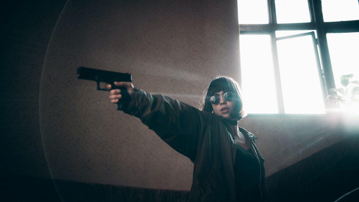Girl Aiming Firearm.